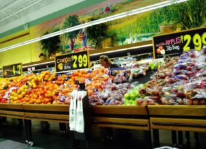 A photo of fruits and vegetables in a supermarket.